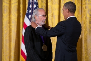 Herb Alpert receives a National Medal of the Arts from President Obama in 2013