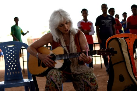 Jesuit Refugee Service/USA Board Members Dave McNulty and Margaret Green Rauenhorst, singer/songwriter Emmylou Harris and JRS International Development Group members Margaret Chin-Wolf and Elaine Teo visit the JRS project in Mai Aini refugee camp in northern Ethiopia, June 8, 2016. The camps are home to refugees from Eritrea, and a significant percentage of the population are unaccompanied children. (Christian Fuchs — Jesuit Refugee Service/USA)